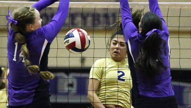 Coronado's Alex Hernandez, 2 fires a shot past Franklin's Caylee Robalin, 14, left, and Ari Reveles earlier this season at Franklin HS. Hernandez has been one of the team's top players this season.