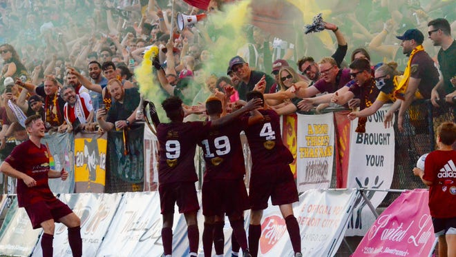 Detroit City FC's Seb Harris (4) celebrates with his teammates and the Northern Guard after scoring a goal in the National Premier Soccer League Midwest Region opener against Dakota Fusion FC on Saturday, July 22, 2017, at Keyworth Stadium in Hamtramck.