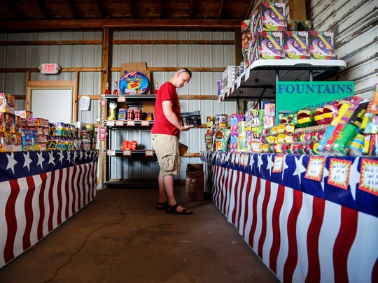 Brant Archer of shops for fireworks at Shooters Fireworks