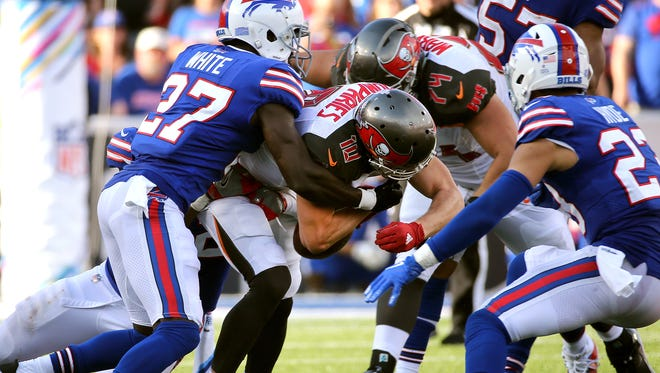 Tampa Bay's Adam Humphries is stripped of the ball by Buffalo's Tre'Davious White.  The Bills recovered and Stephen Hauschka kicked 30-yard field goal to win the game with 14 seconds remaining.