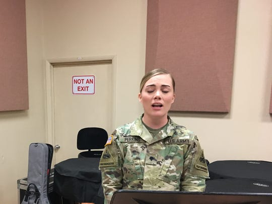 Spc. Emily Perkins sings during a recent 1st Armored