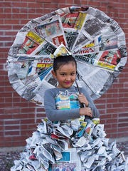 Girl with the news paper dress.