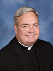 Father Robert J. Fisher has been named to be an Auxiliary