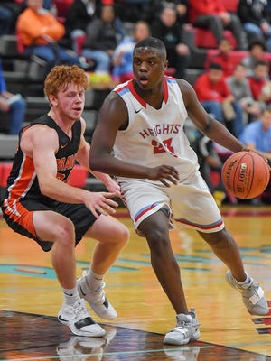 Senior Harvey Davis, right, returns for Shawnee Heights after averaging 10.2 points and 5.6 rebounds a year ago.