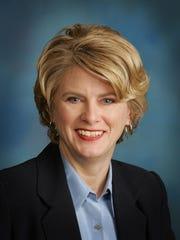 Michelle Krebs, auto analyst.