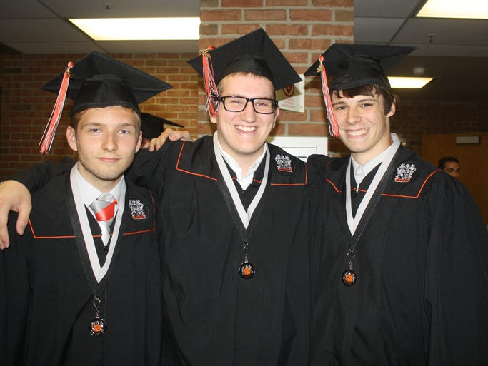 Dillon Osborne, Nicholas Hayes and Boone Meadows take time for a photograph before the Ryle High School graduation ceremony on Friday, June 6.