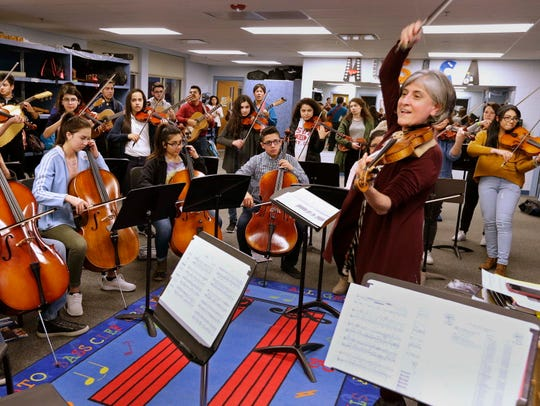 Students from the Latino Arts Strings Program will