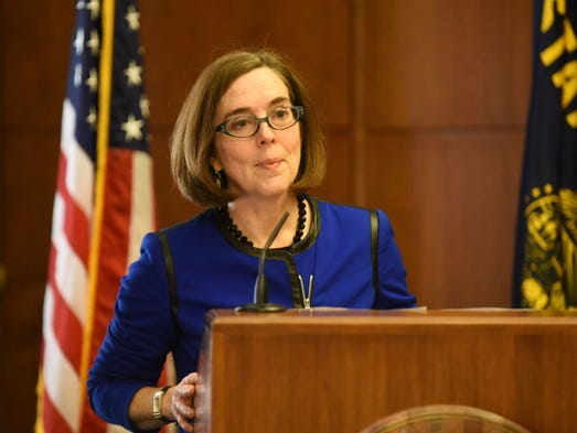 Gov. Kate Brown speaks to the media during a press