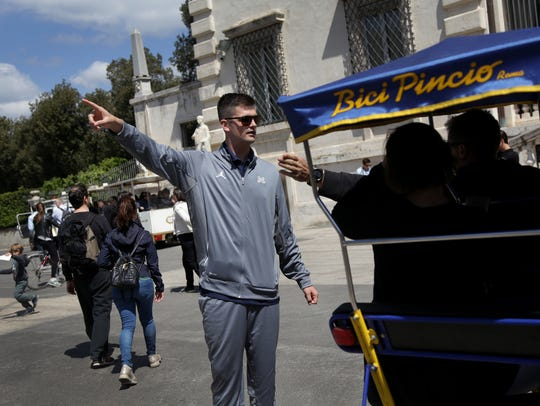 Michigan quarterback Wilton Speight asks for directions