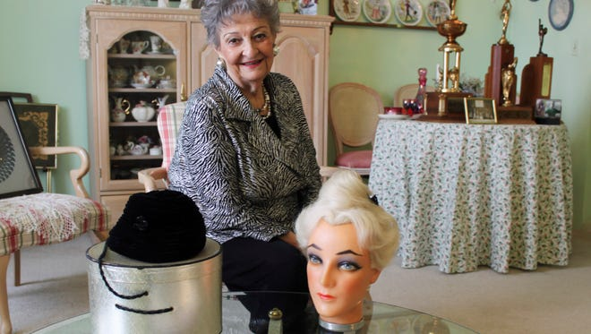 Retired hairstylist Margaret Vinci Heldt, poses at her apartment in Elmhurst, Ill., in 2011.