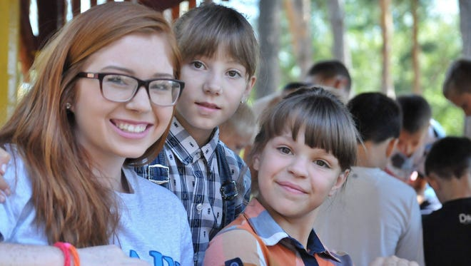 Volunteer Asia Davison is pictured with orphans she has been ministering to in the Kirovograd region of Ukraine.