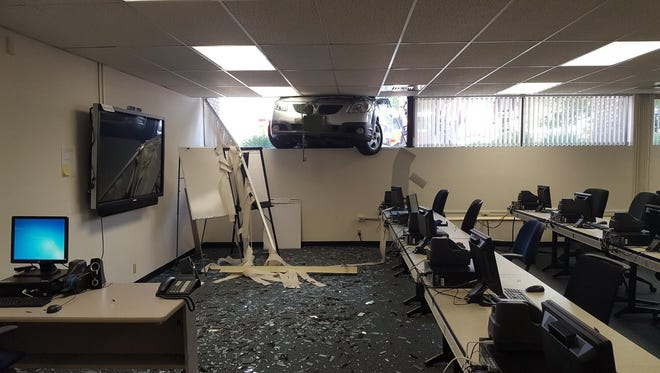 A woman crashed her car into Huntington Bank in Kaukauna on Monday afternoon. No one was injured.