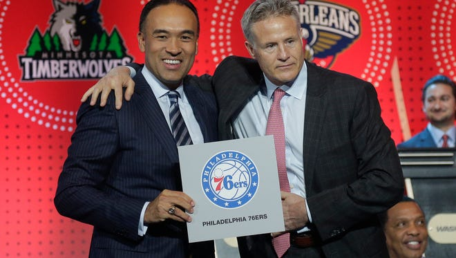 NBA deputy commissioner Mark Tatum, left, poses for a photo with Philadelphia 76ers head coach Brett Brown during the NBA basketball draft lottery, Tuesday, May 17, 2016, in New York. The 76ers won the top pick in this year's draft. (AP Photo/Julie Jacobson)