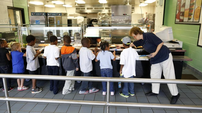 Lake Forest Elementary School students make their way through the lunch line in 2014.