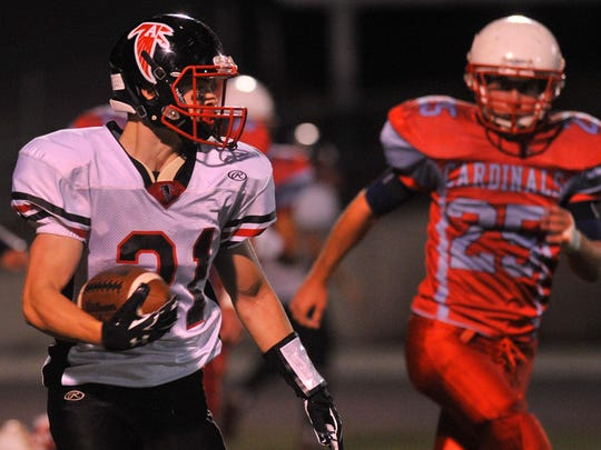 Newman Catholic's Jeremy Damask, right, tries to chase