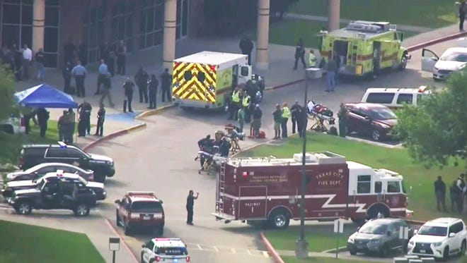 In this image taken from video emergency personnel and law enforcement officers respond to a high school near Houston after an active shooter was reported on campus,  in Santa Fe, Texas, May 18, 2018.