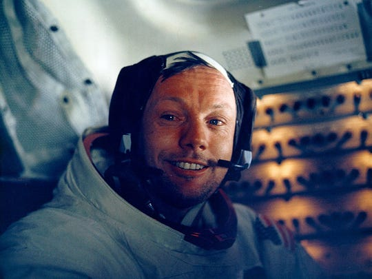 "Apollo 11 astronaut Neil Armstrong, the first man to walk on the moon, smiles inside the Lunar Module ""Eagle.""  Getty Images 30Th Anniversary Of Apollo 11 Landing On The Moon (19 Of 20): Astronaut Neil Armstrong Inside The Lunar Module. Man's First Landing On The Moon Occurred At 4: 17 P.M. On July 20, 1969 As Lunar Module ""Eagle"" Touched Down Gently On The Sea Of Tranquility On The East Side Of The Moon. The Lm (Lunar Module) Landed On The Moon On July 20, 1969 And Returned To The Command Module On July 21. The Command Module Left Lunar Orbit On July 22 And Returned To Earth On July 24, 1969. Apollo 11 Splashed Down In The Pacific Ocean On July 24 1969 At 12: 50: 35 P.M. Edt After A Mission Elapsed Time Of 195 Hrs, 18 Mins, 35 Secs. (Photo By Nasa/Getty Images)"
