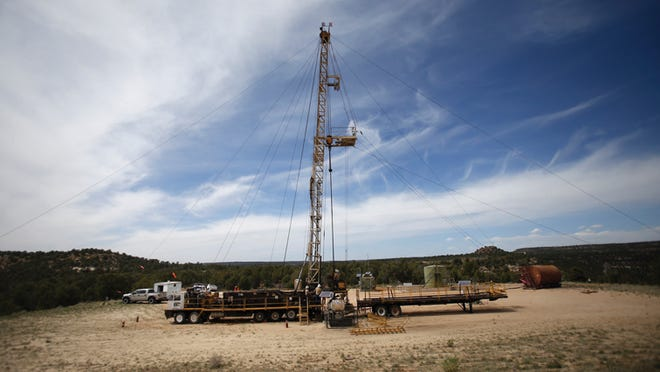 A Hurricane Air & Well Service work over rig is at a natural gas well site in Middle Mesa in this undated file photo. Farmington Chamber of Commerce President Jamie Church said a moratorium on oil and natural gas leasing on federal lands and a moratorium on permitting could have a negative impact on the state and local budgets.