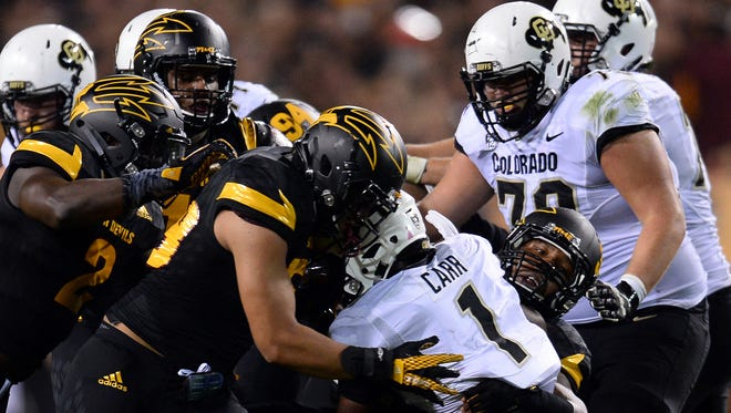 Colorado Buffaloes running back Patrick Carr is tackled by Arizona State's defense.