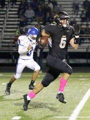 Jason Rodriguez breaks free for one of his three touchdowns Friday for Corning in a win over Horseheads at Corning Memorial Stadium.