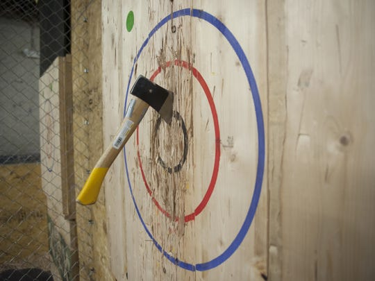 An axe is lodged in a targed at Urban Axes in Philadelphia.