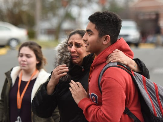 Olivia Rahman is overcome with emotion when she sees her son, Joseph, released from a lockdown at Dumont High School on Feb. 26. Rahman had fainted earlier, while she waited for her son and was taken by ambulance for treatment, but she was back in time to greet her son when he was let out of school.