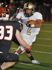 Rider runningback Tre Byrd (2) cuts outside as Aledo's Ryan Anderson (33) moves in for the tackle Thursday night in Saginaw.