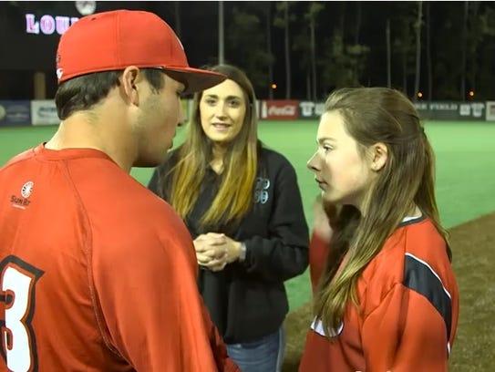 Cajuns second baseman Brenn Conrad talks with Paige