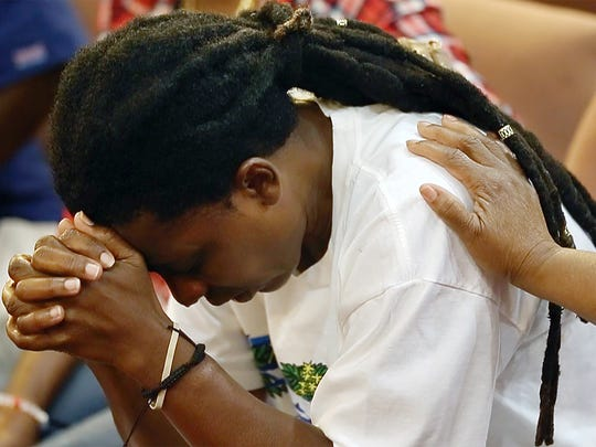 Veronica Morse weeps as family members share the story of her brother's murder during a restorative healing meeting recently at the Followers of Christ Fellowship Ministries church in Fort Myers.