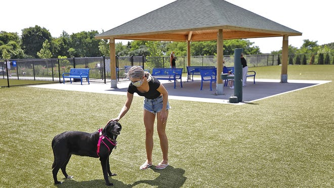 """Faith Fitzpatrick, 20 plays with family dog """"SallyÓ.  The new Quincy dog park of Quarry Street has all the things dogs and their owners could want on Tuesday July 21, 2020 Greg Derr/The Patriot Ledger"""
