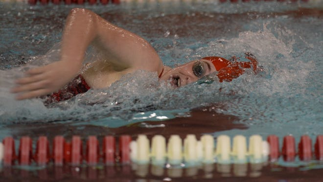 Richmond's Lily Vincent swims the 200 yard freestyle against Muncie Central during a dual swimming and diving meet Tuesday, Dec. 15, 2015 at Tiano Pool.