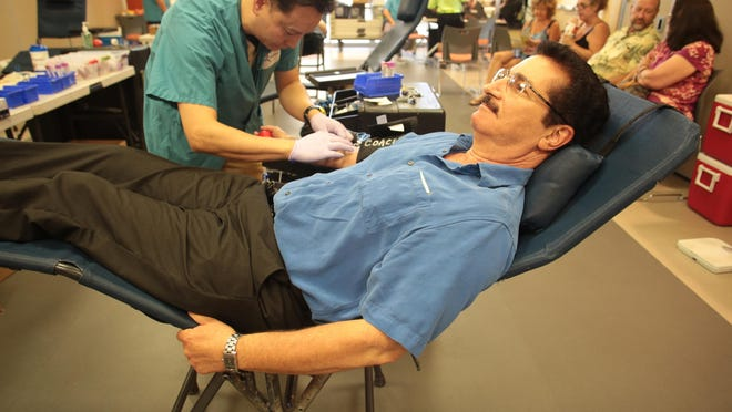 Dr. Paul M. Ross, a chiropractor practicing in Desert Hot Springs, has his blood drawn.