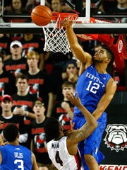 Karl-Anthony Towns of the Kentucky blocks a shot by Charles Mann of Georgia at Stegeman Coliseum on March 3, 2015, in Athens, Ga.