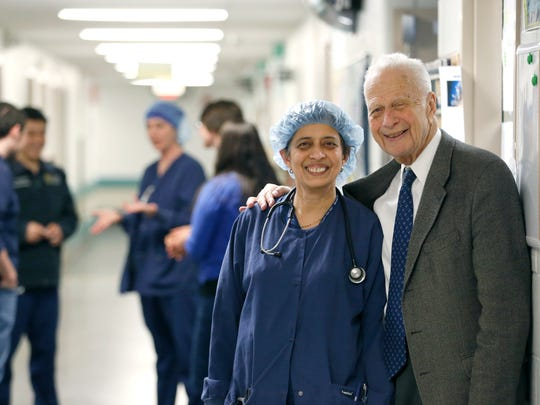 Dr. Seymour Schwartz, a URMC retired surgeon who turns 90 on Jan. 22, is seen here with Dr. Lata Sabnis near the operating rooms at Strong Memorial Hospital.