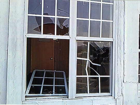 A building that holds two apartments and a laundromat was allegedly vandalized Friday night. Windows were broken out and a storm door was damaged in the building.