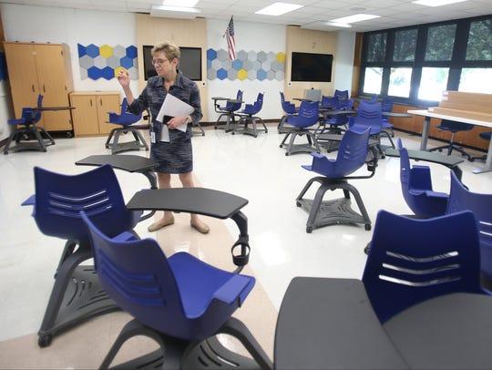 Rye Neck Superintendent Barbara Ferraro shows how schools