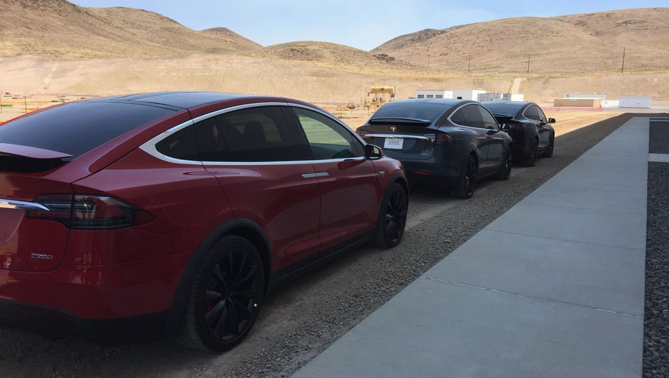 Teslas are lined up Tuesday, July 26, 2016 at the edge