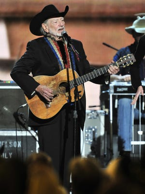 Willie Nelson performs during the 46th annual CMA Awards show Nov. 1, 2012.