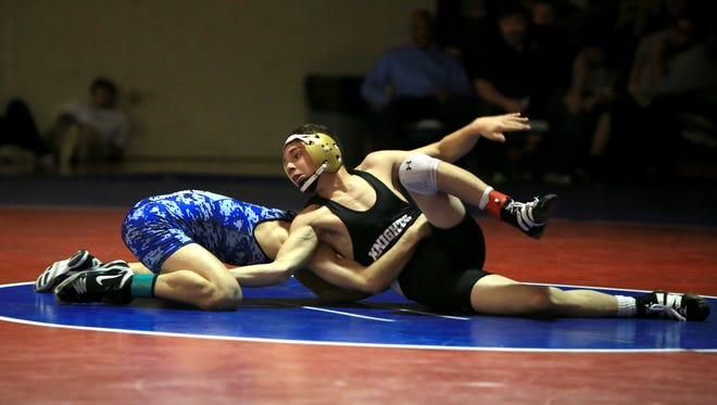 Josh Blatt, right, is one of the top wrestlers for North Henderson.