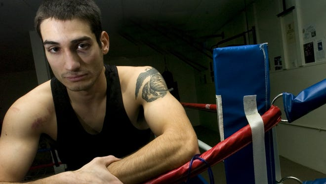 Nicholas Palmier, seen in this January 2009 photo while he was a Golden Gloves boxer, is the Franklin County sheriff's deputy who fatally shot Jesse Beshaw on Sept. 16 in Winooski.
