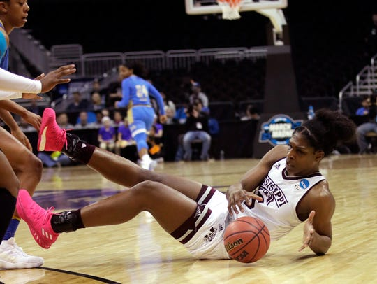 Mississippi State center Teaira McCowan (15) goes to