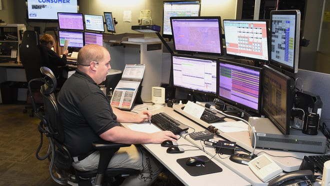 Dispatcher Adam Bolgiano from the Stark County Sheriff's Office takes a call from a Stark County resident in December 2018. Stark County's 911 system is expected to get an upgrade this fall that would allow people seeking help from 911 to do so by text rather than just a voice call.
