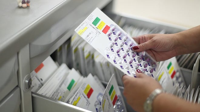 Registered nurse Amy Allen Mullins is the clinical manager at Avante in Waynesboro. Mullins shows an example of a daily medication routine that a nurse would administer to a resident at the home.