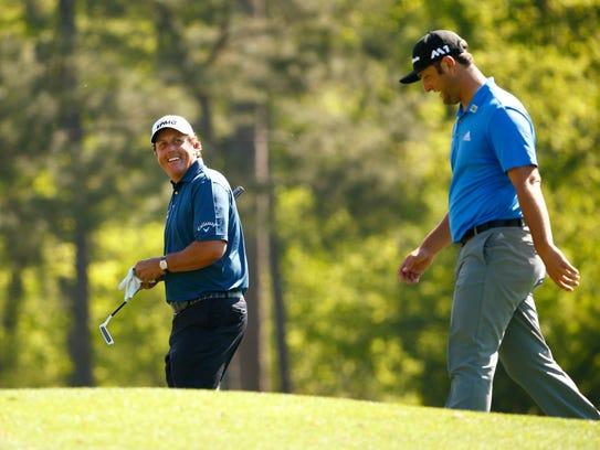 Masters champion Phil Mickelson and Jon Rahm laugh