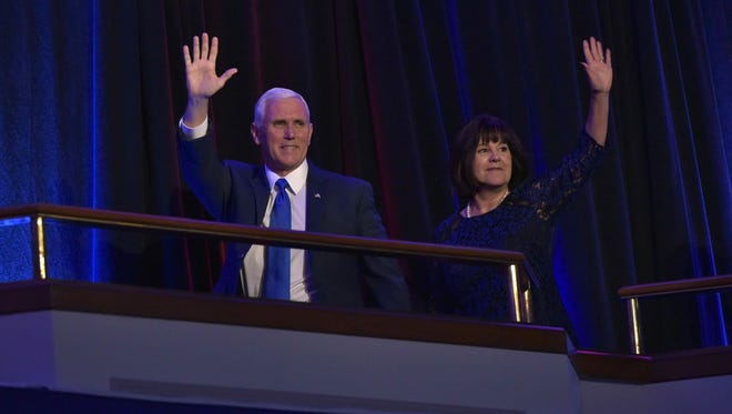 Republican Vice President-elect Mike Pence and his wife, Karen, wave to supporters early Wednesday, Nov. 9, 2016, at the New York Hilton Midtown.