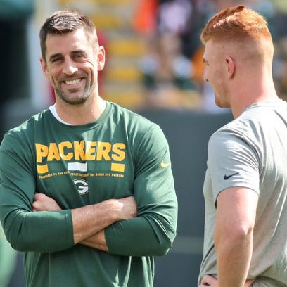 Green Bay Packers quarterback Aaron Rodgers talks with