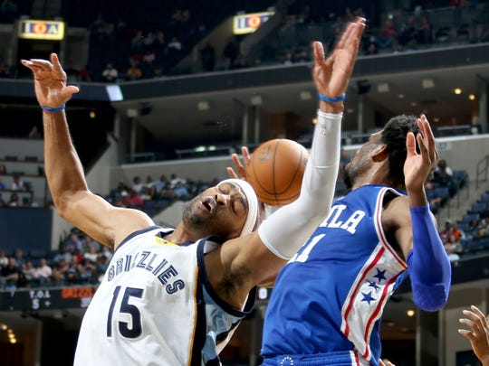 Memphis Grizzlies swingman Vince Carter takes contact as he battles for a rebound with the Philadelphia 76ers' Joel Embiid at FedExForum.
