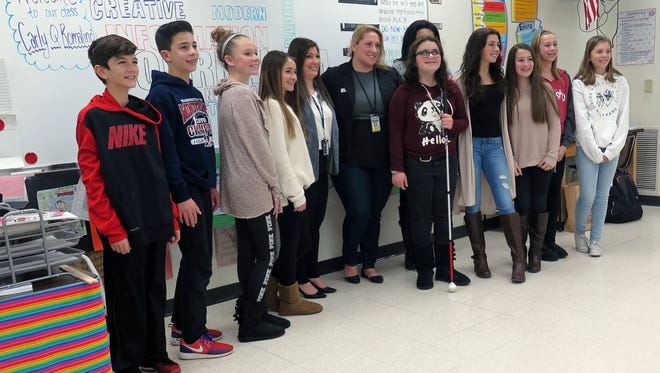 Courier-Post reporter Carly Q. Romalino (center) visited Washington Township's Bunker Hill Middle School Tuesday to hear what Amanda Wesh's (left of center) seventh grade class had to say about the future of their town and the United States.