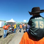Dylan Stone, 4, sits on Nolan Stone's shoulders at CSU's Ag-Day Saturday Sept. 28, 2013, outside Hughes Stadium.