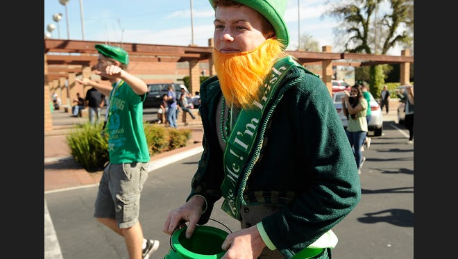 Thousands watched as green wearing revelers participated in the St. Patrick's Day Parade Saturday through downtown Visalia.